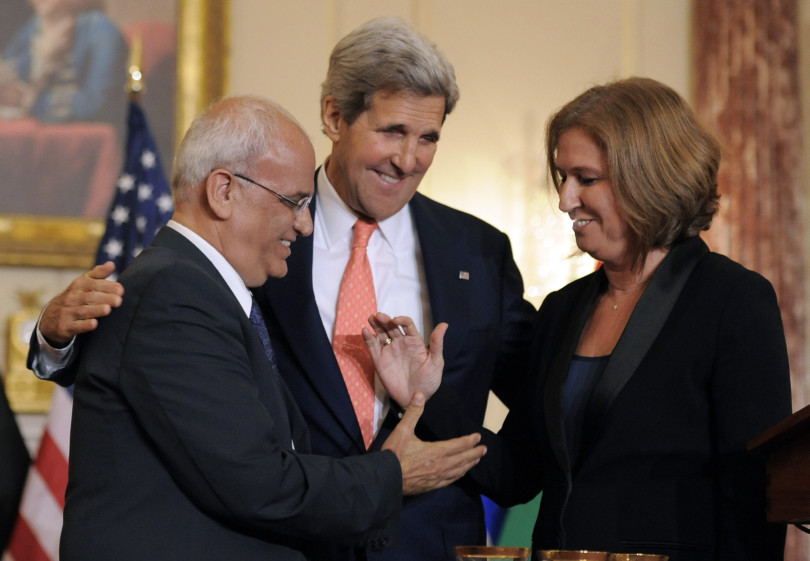 epa03807788 US Secretary of State John Kerry (C) brings Israeli Justice Minister Tzipi Livni (R) and chief Palestinian negotiator Saeb Erekat together for a handshake as they conclude a press conference after Middle East peace talks, at the State Department, in Washington DC, USA, 30 July 2013. Negotiators for Israelis and Palestinians will meet again in the region within two weeks to continue peace talks, US Secretary of State John Kerry said 30 July.  EPA/MIKE THEILER